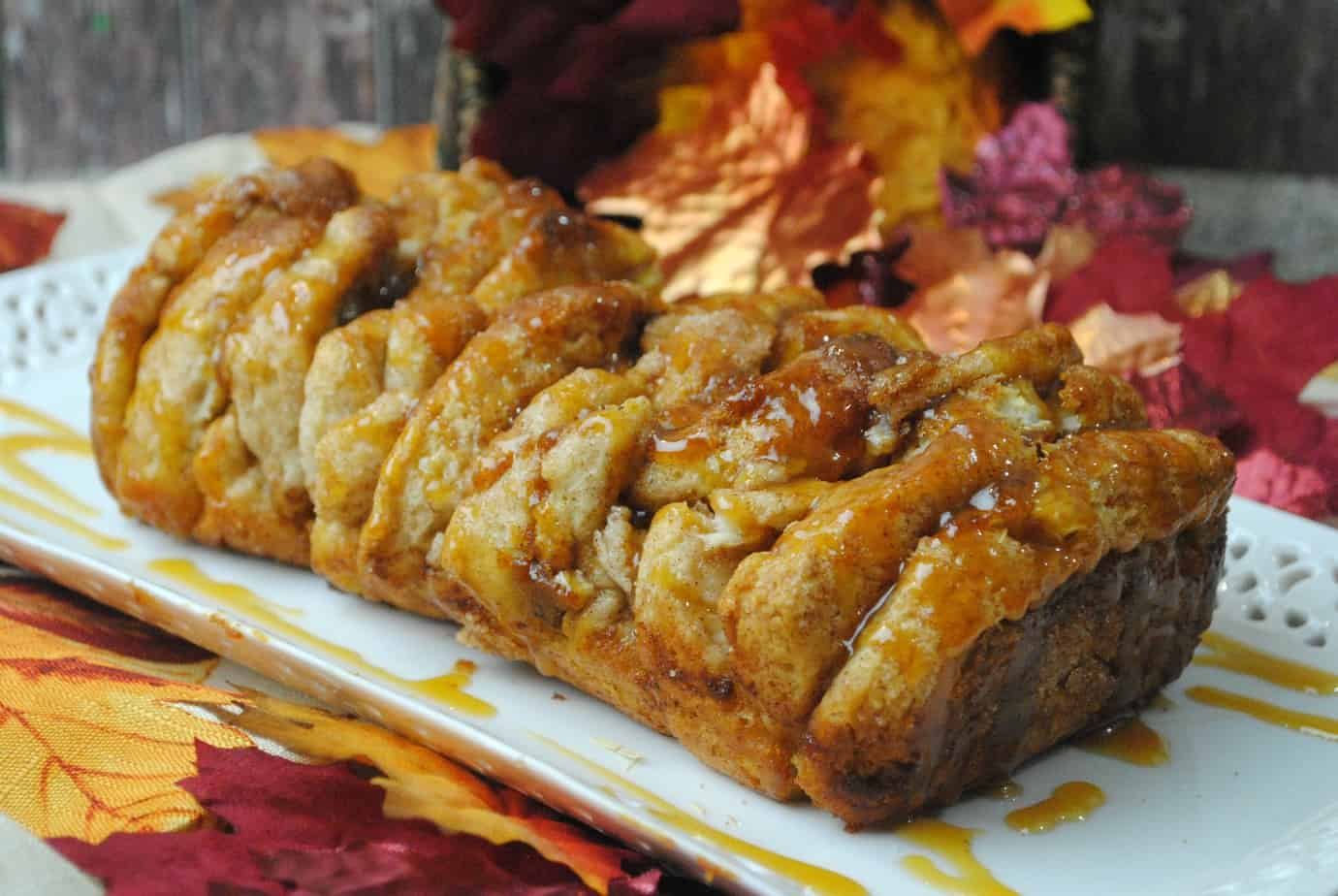 Pull Apart Pumpkin Bread on a white tray with leaves in the background