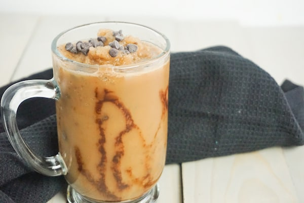 java Chip frappuccino on a grey wood background with a black linen