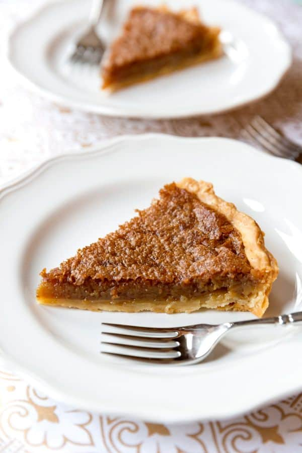 brown sugar pie on two white plates with forks on the plate