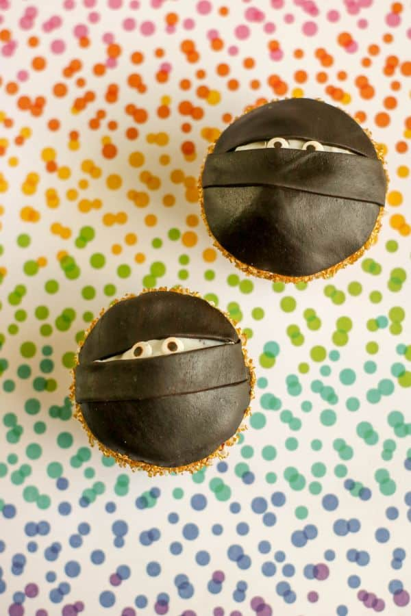 two ninja cupcakes on a multi-colored dotted background
