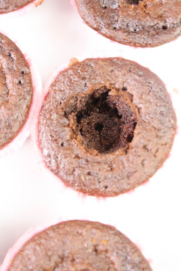 chocolate cupcakes with a hole in the center of them