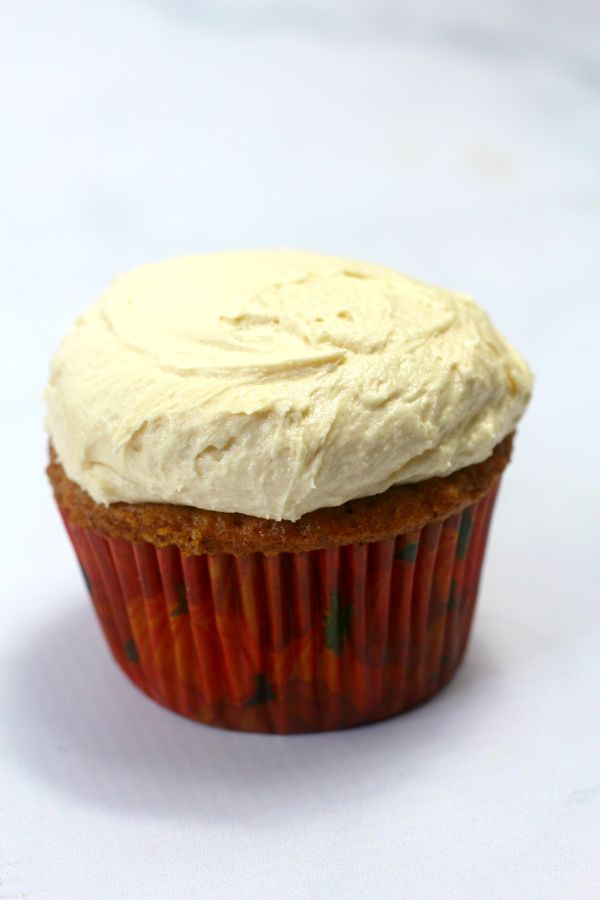 a pumpkin spice cupcake with buttercream frosting